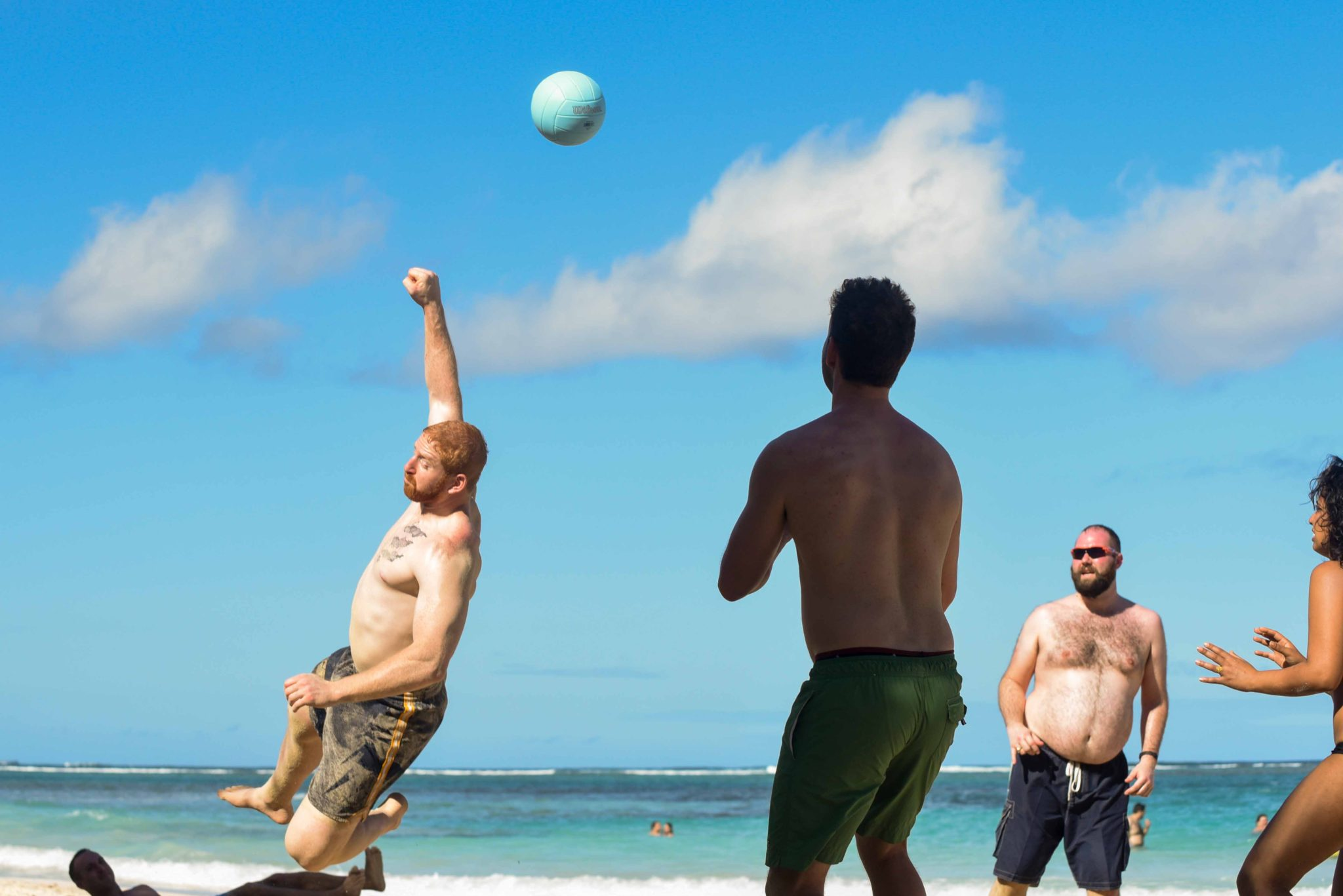 Wedding guests playing volleyball