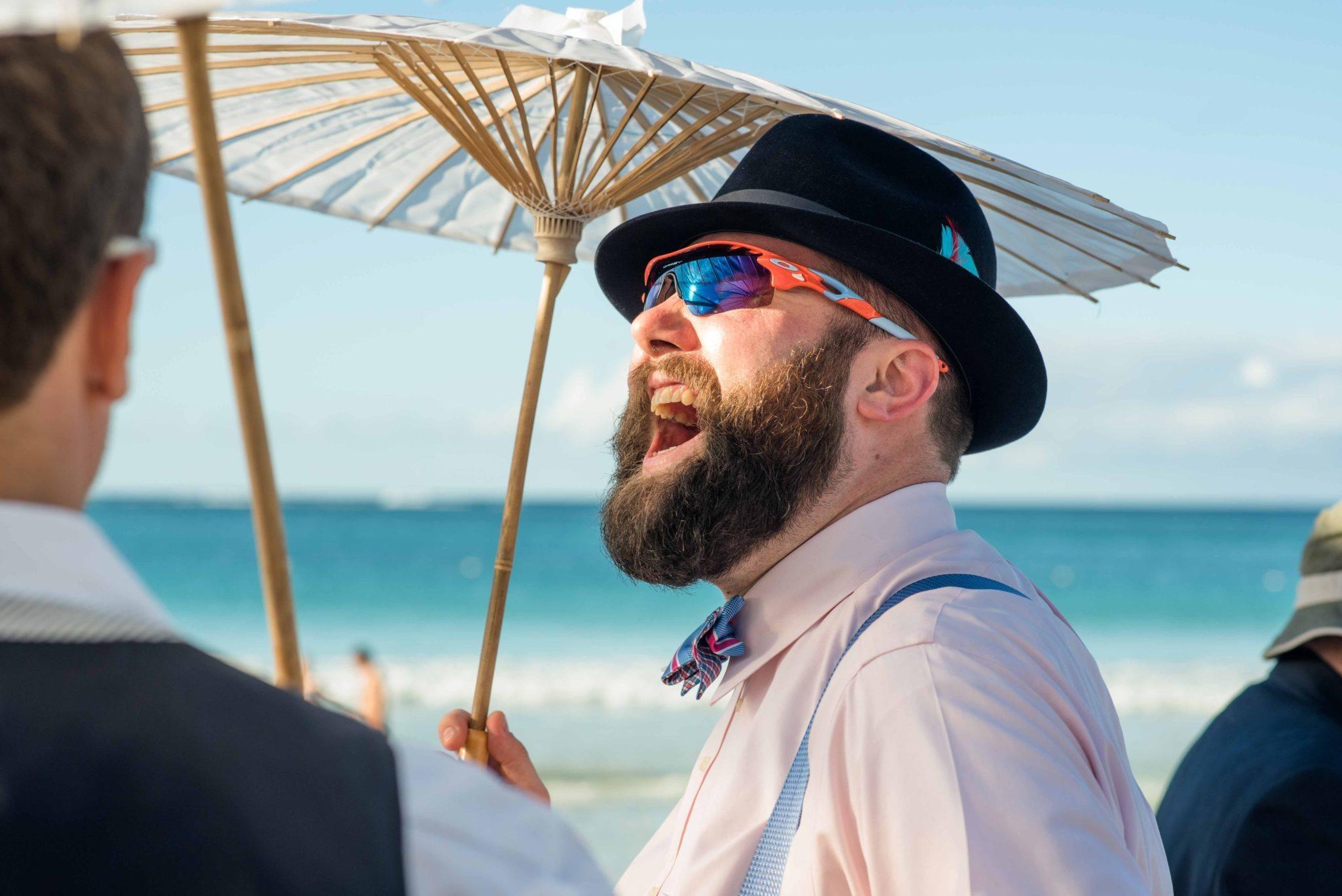 Guest laughing before beach wedding in Culebra
