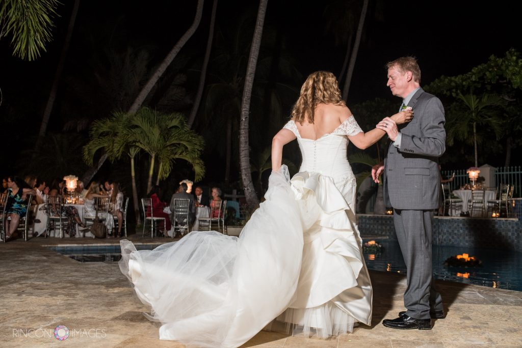 Bride and groom dancing their first dance during their wedding reception.