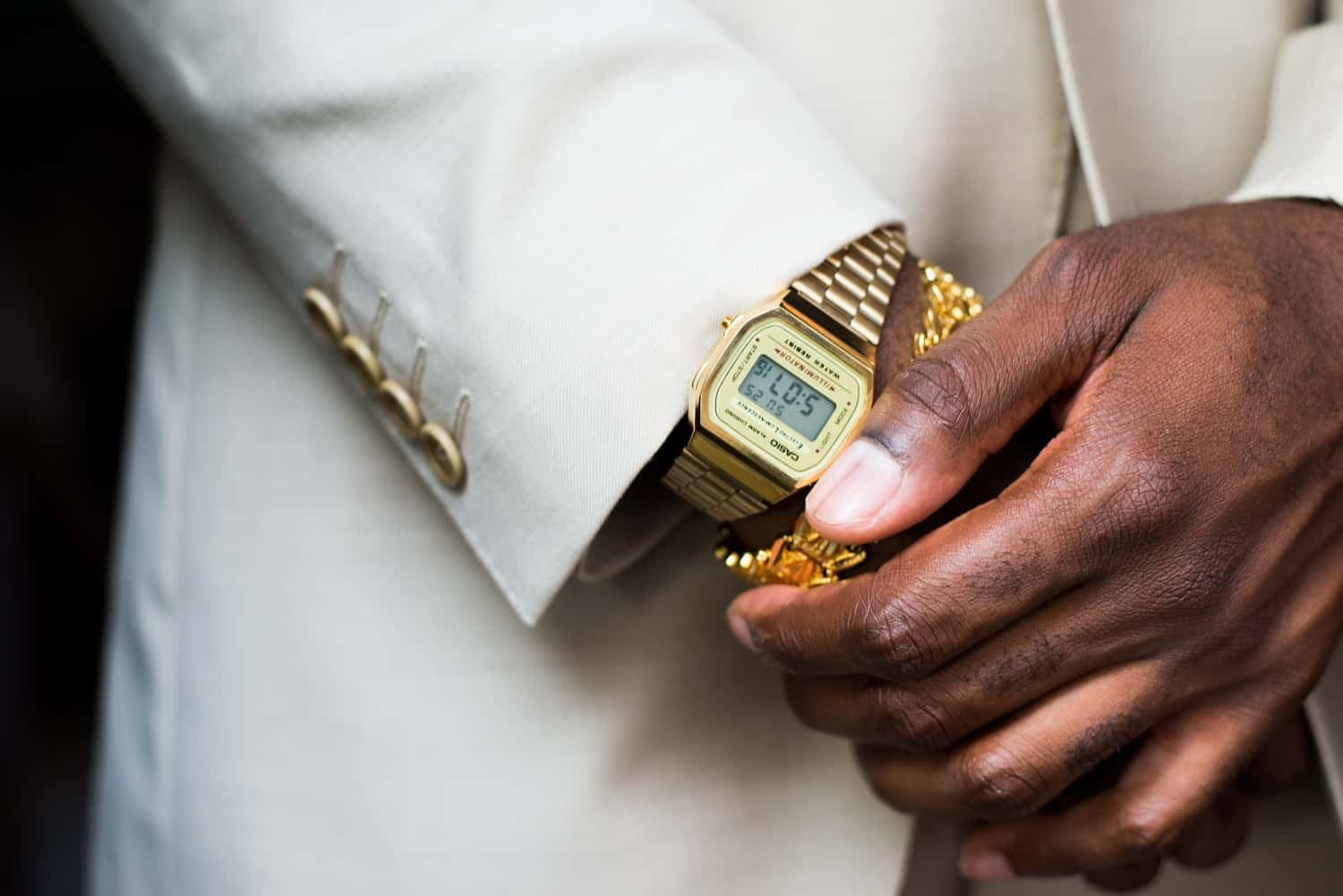 Groom wearing gold casio watch for his wedding