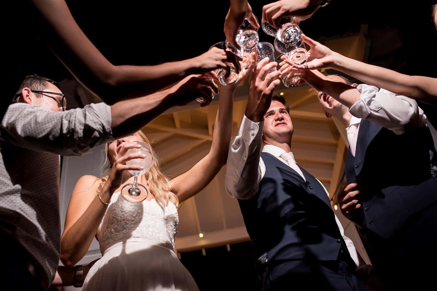 Sharing a cheers during the wedding reception