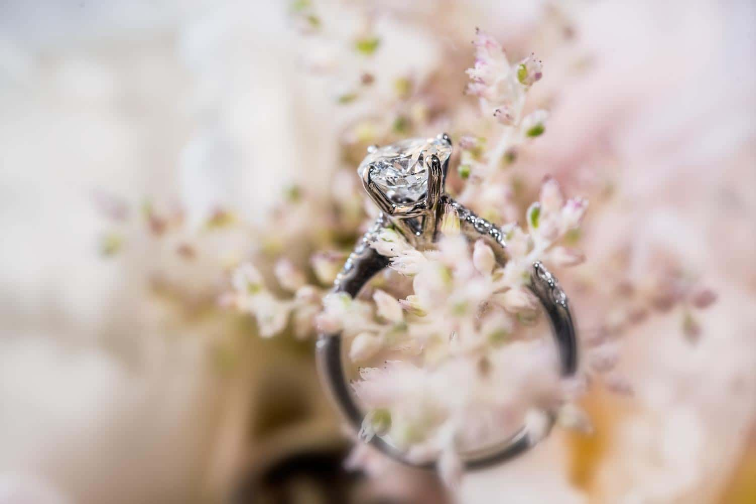 Wedding ring nestled in a tropical flower arrangement