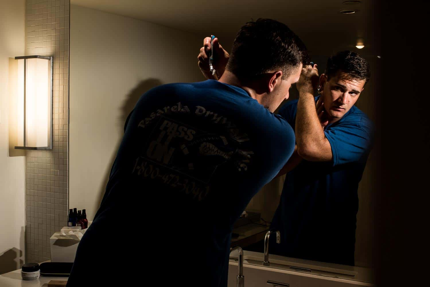 Groom shaving in his hotel room