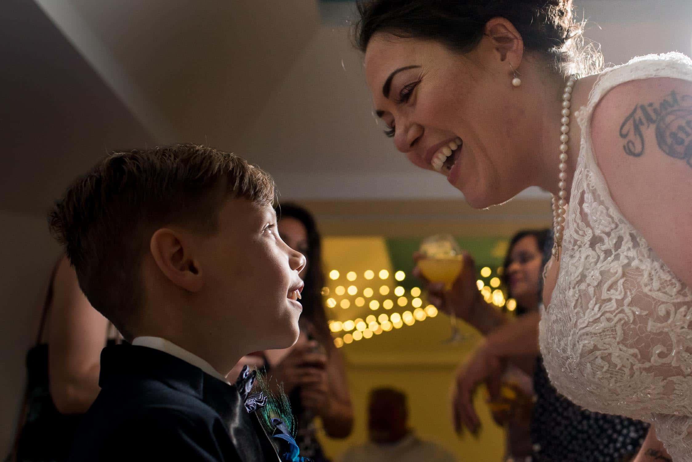 Mother and son smiling during wedding reception