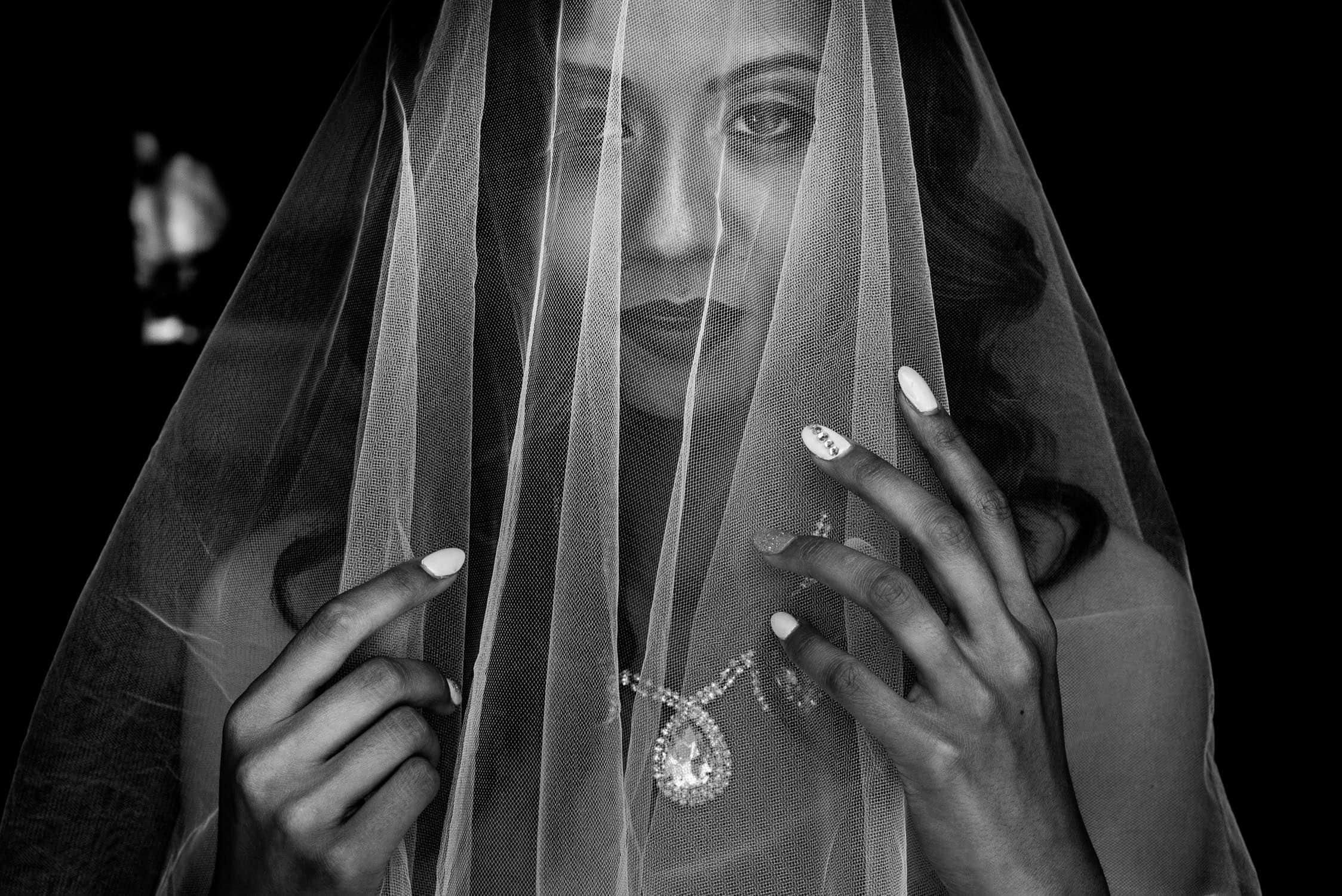 Bride holding veil black & white wedding photography