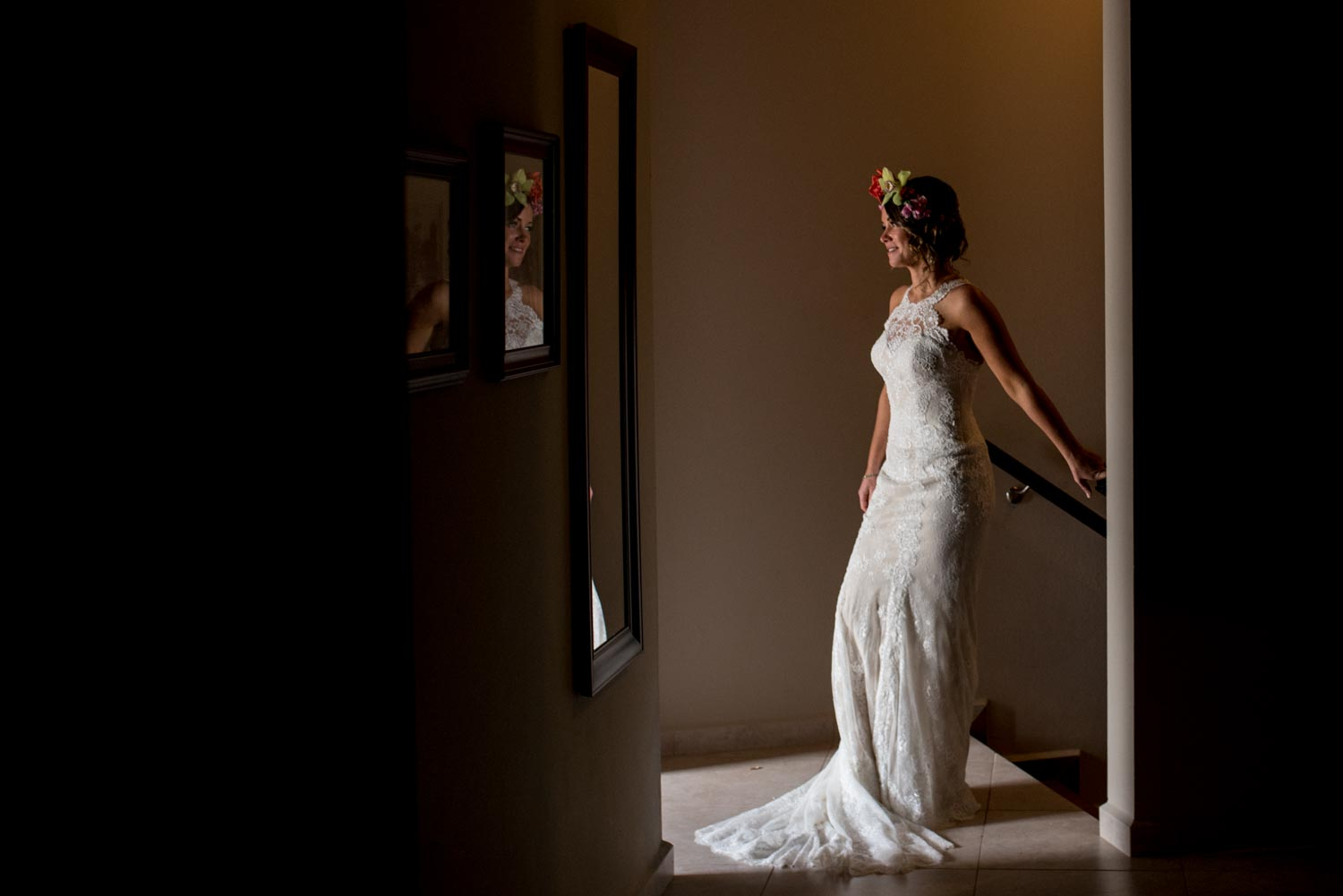 Bride standing posed in a hallway wearing a white wedding dress
