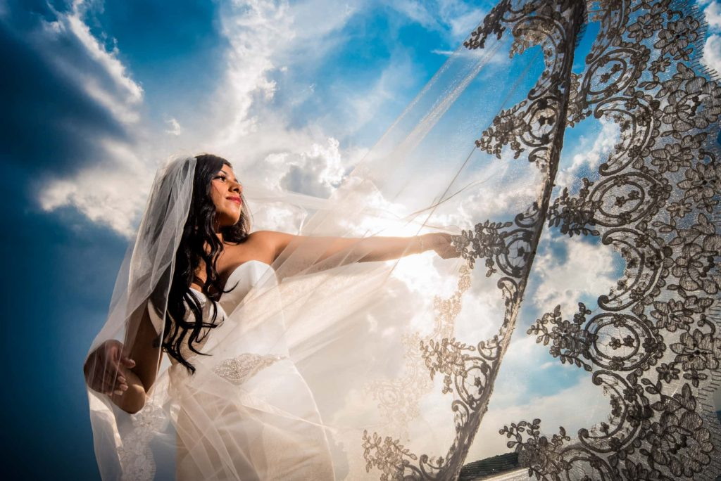 Incredible bridal portrait with bright blue sky