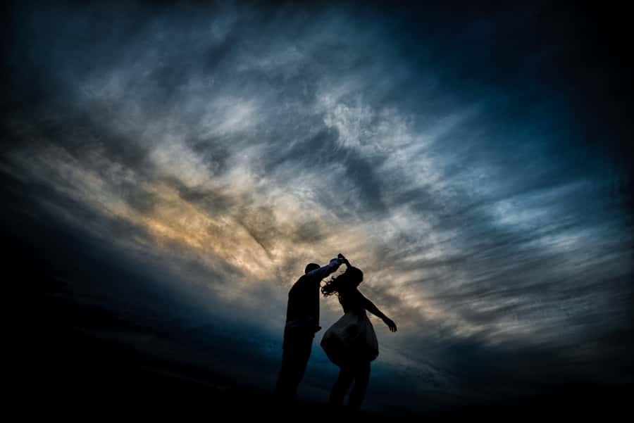 Dramatic sunset photo of a couple