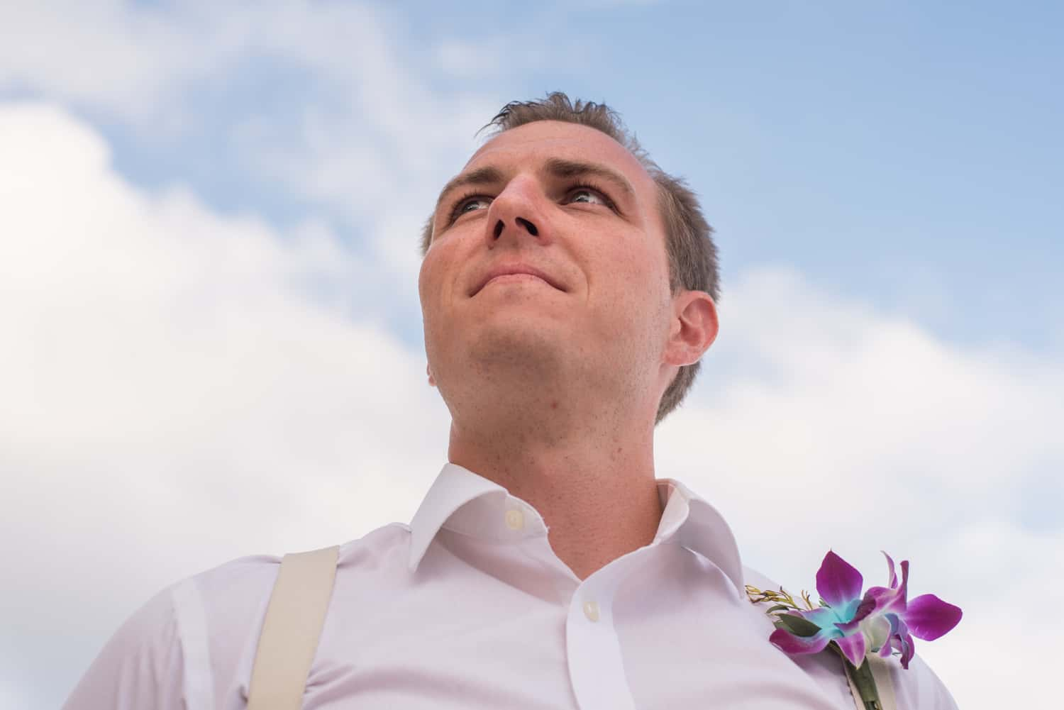 Groomsman with orchid bouttenniere