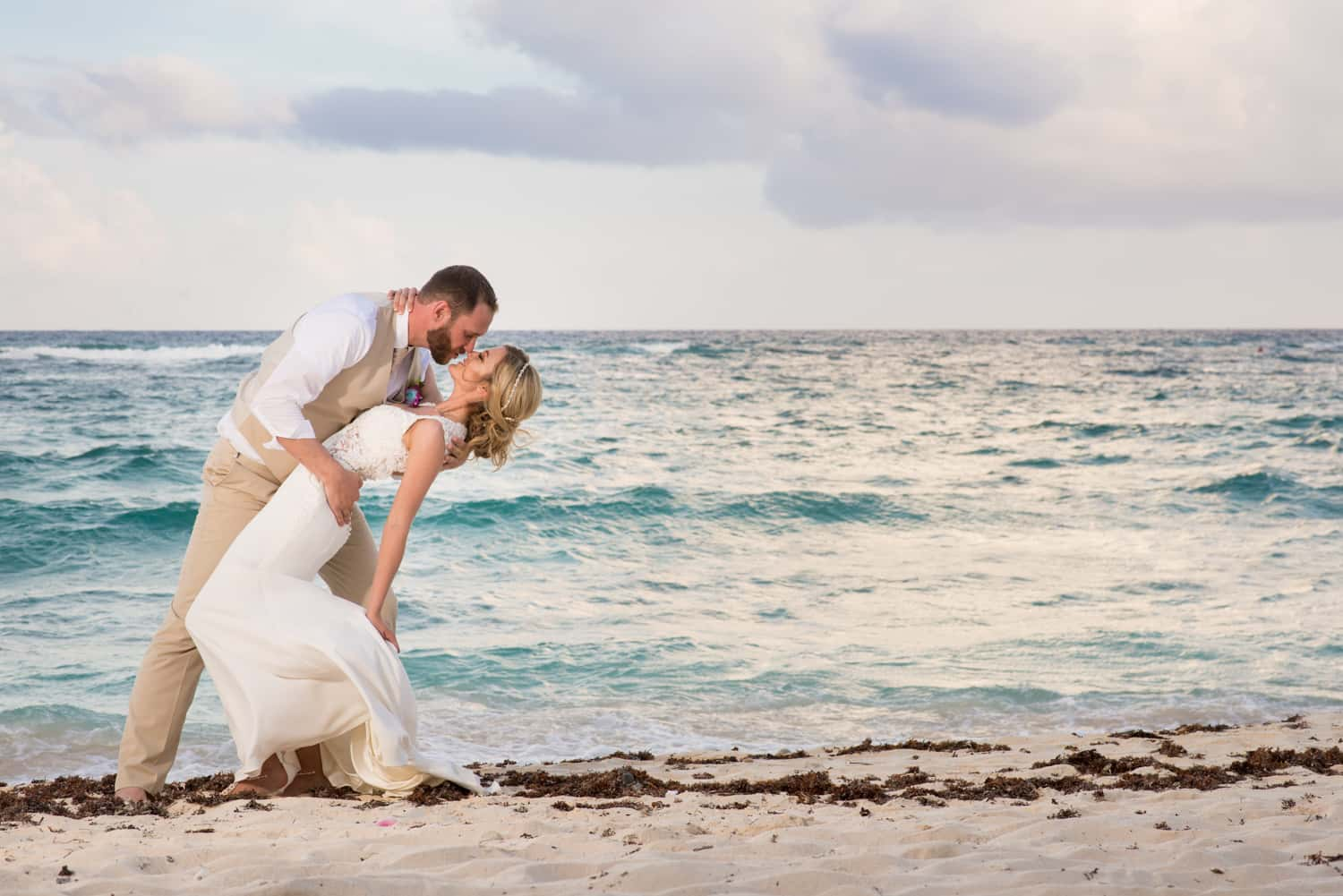 Wedding portrait of bride and groom on the beach in Tulum Mexico