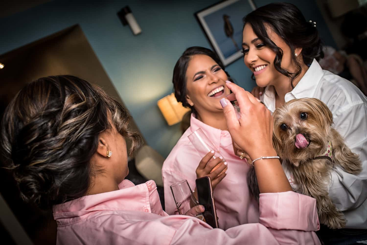 Bridesmaids in pink shirts laughing and smiling