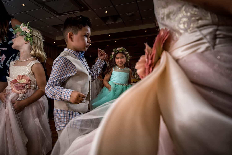 flower girls dancing at wedding reception