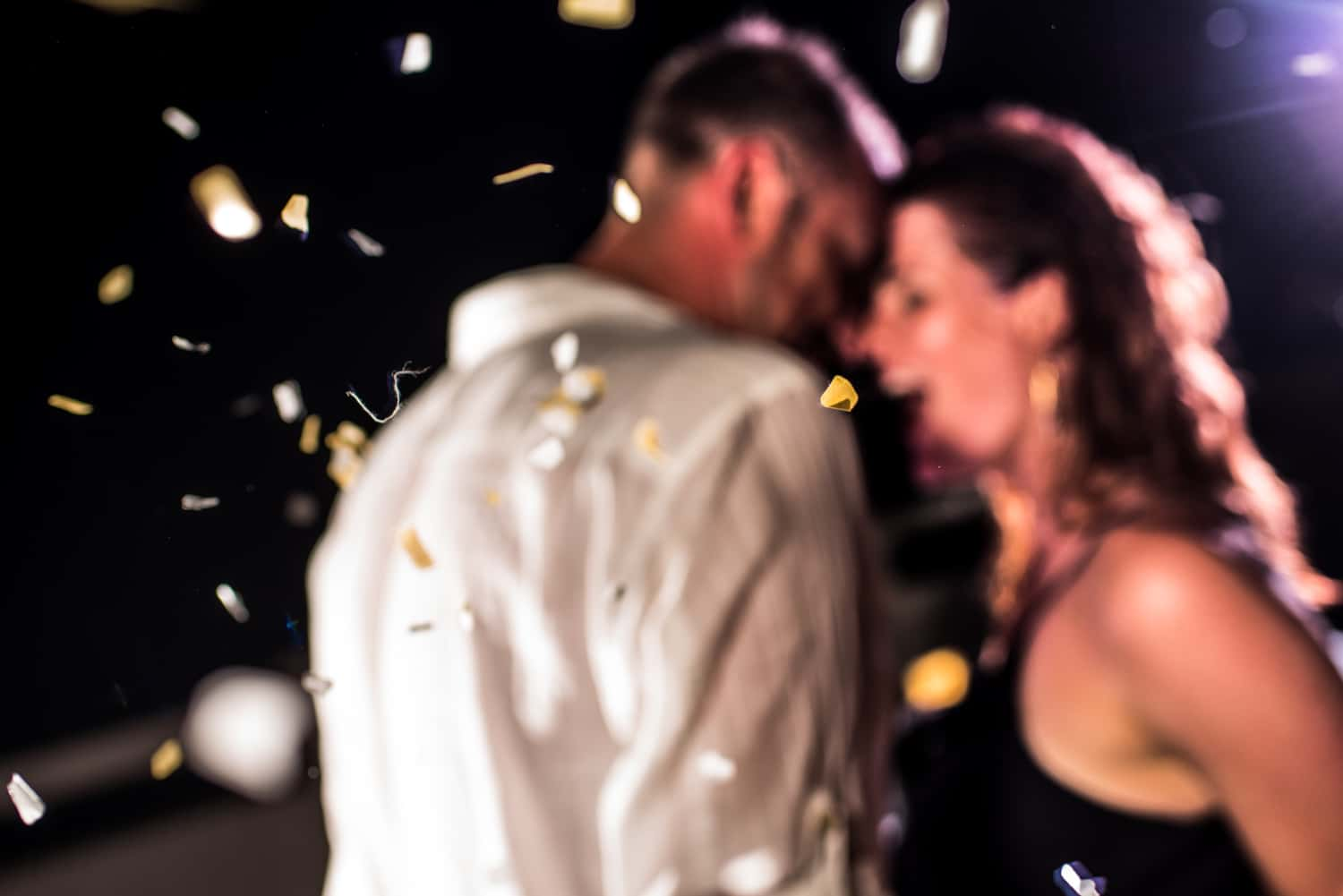 couple dancing with falling confetti