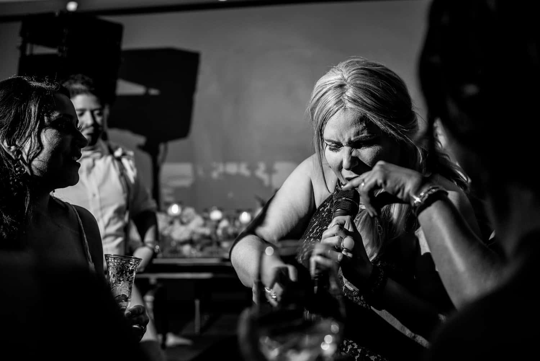 Wedding singer emotionally singing into microphone