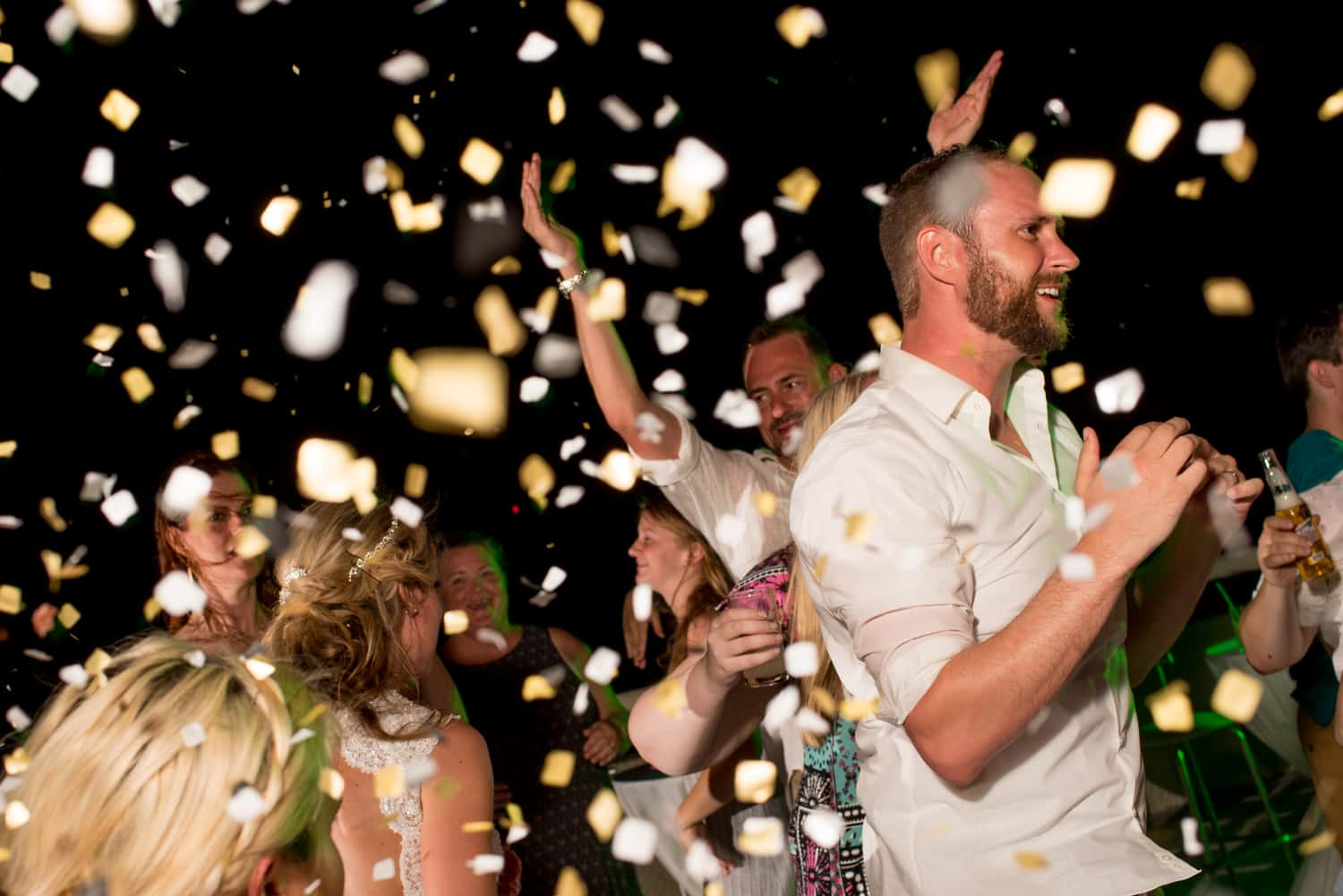 Wedding reception with white and yellow confetti