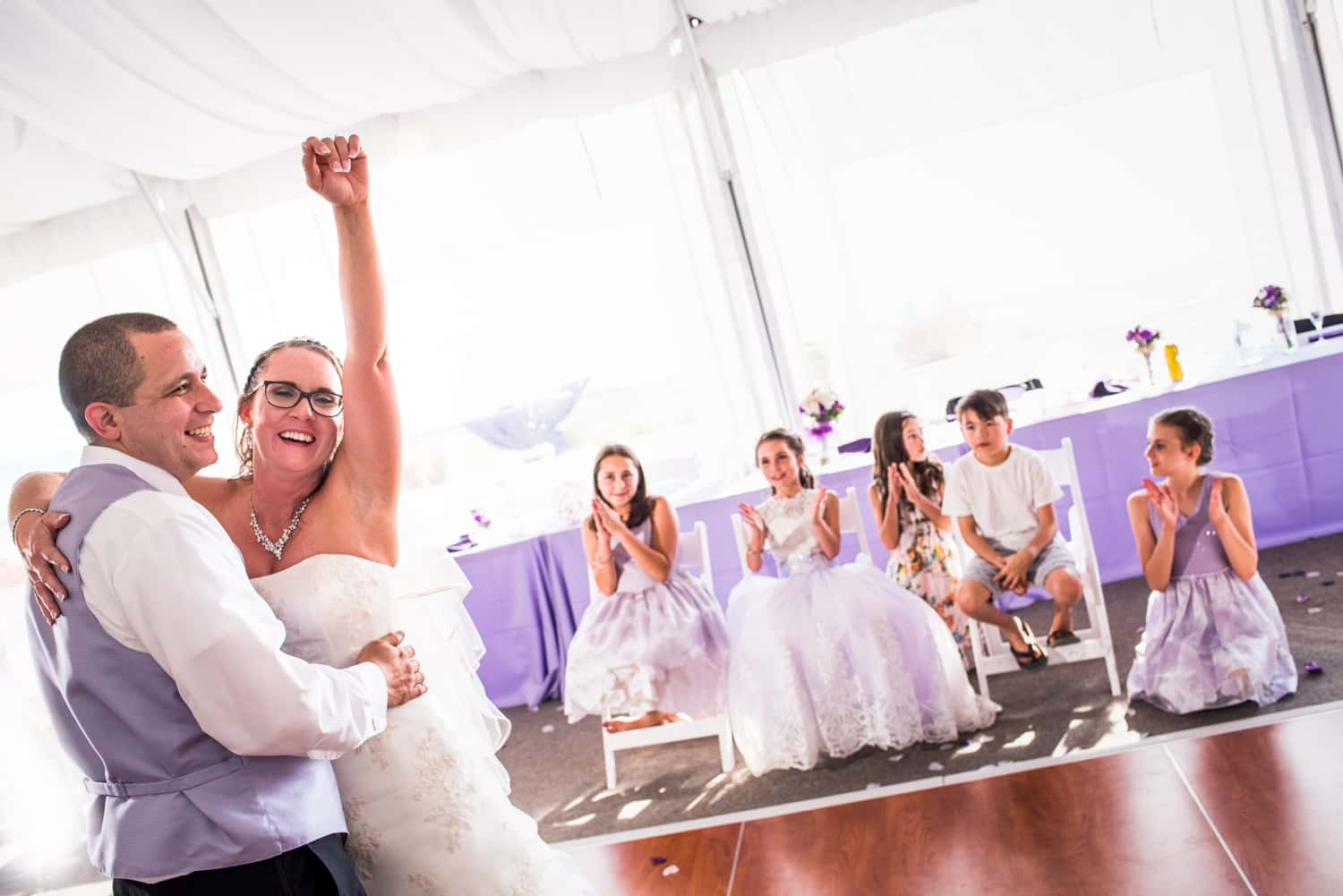 Bride fist pumping after her wedding