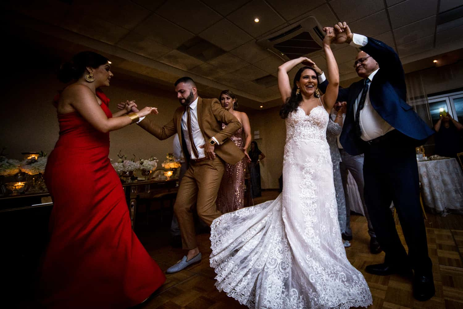Bride in a white wedding dress dancing with her guests at Copa Marina