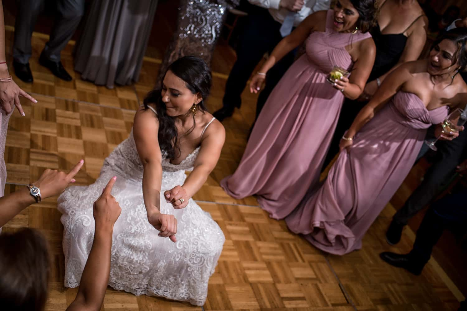 Bride dropping her booty to the ground during her wedding party