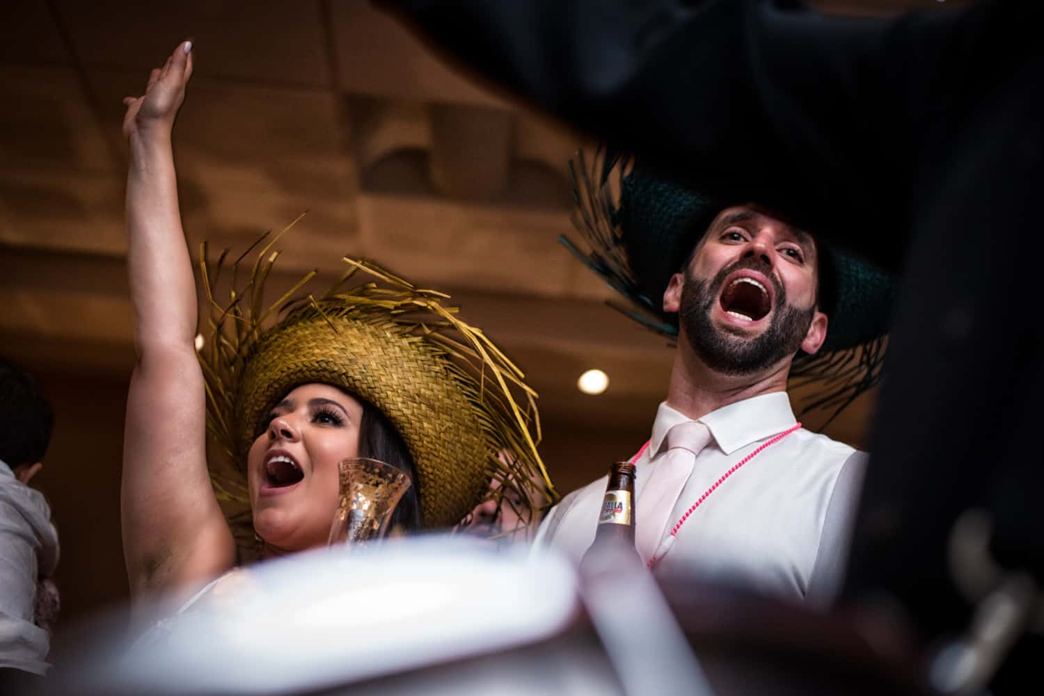 Bride and groom cheering