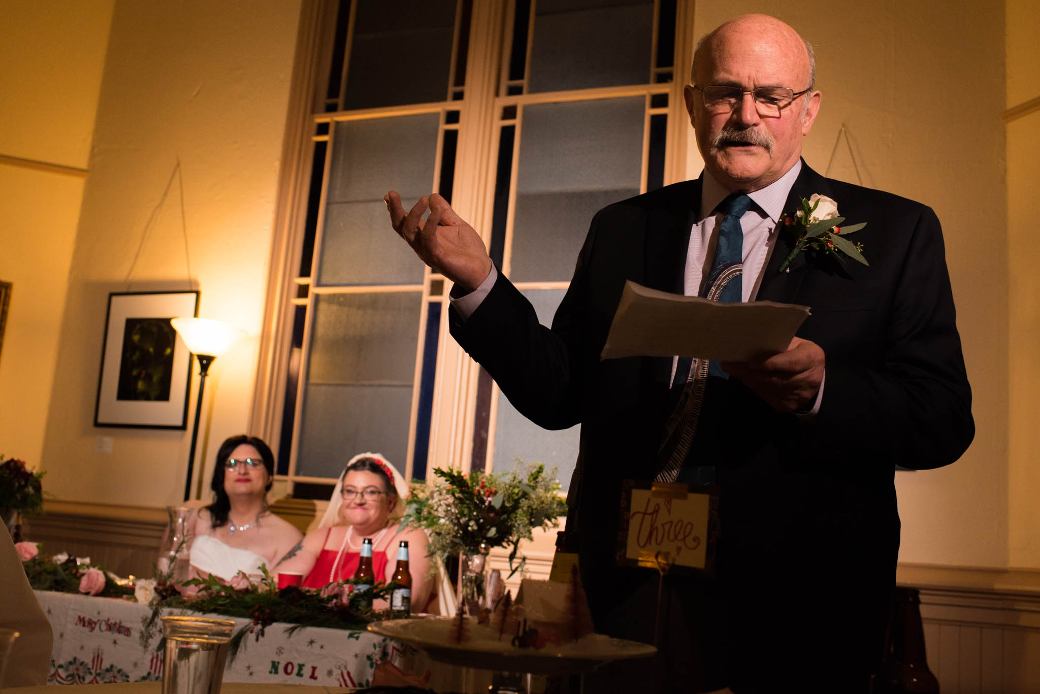 Father of the bride giving a toast during wedding reception