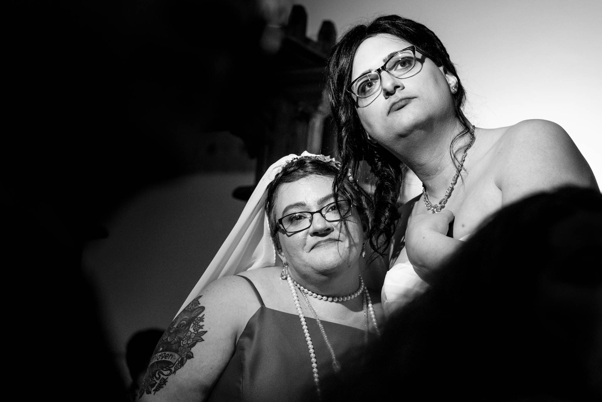 Photograph of two brides during wedding reception