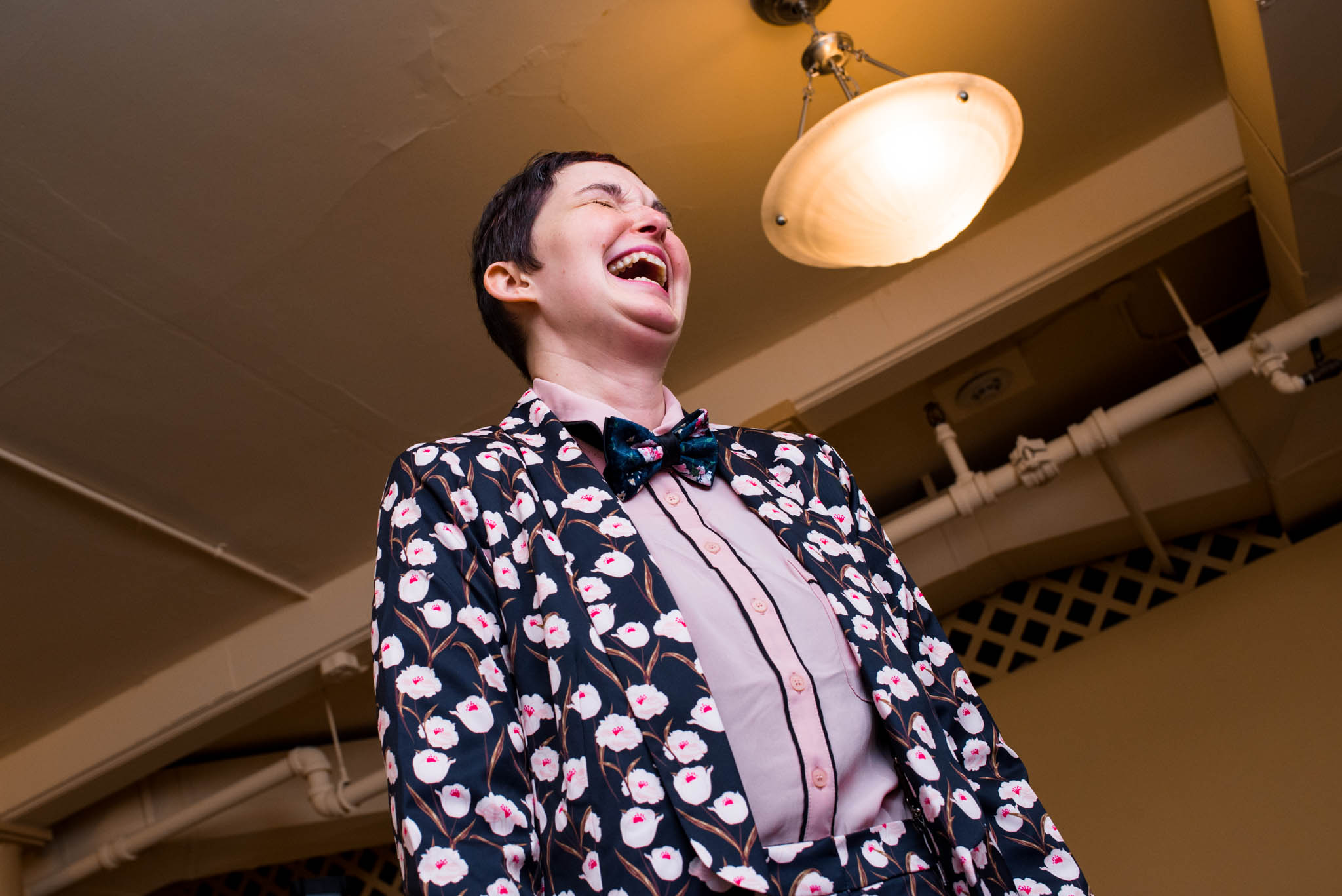 Woman laughing wearing flower suit