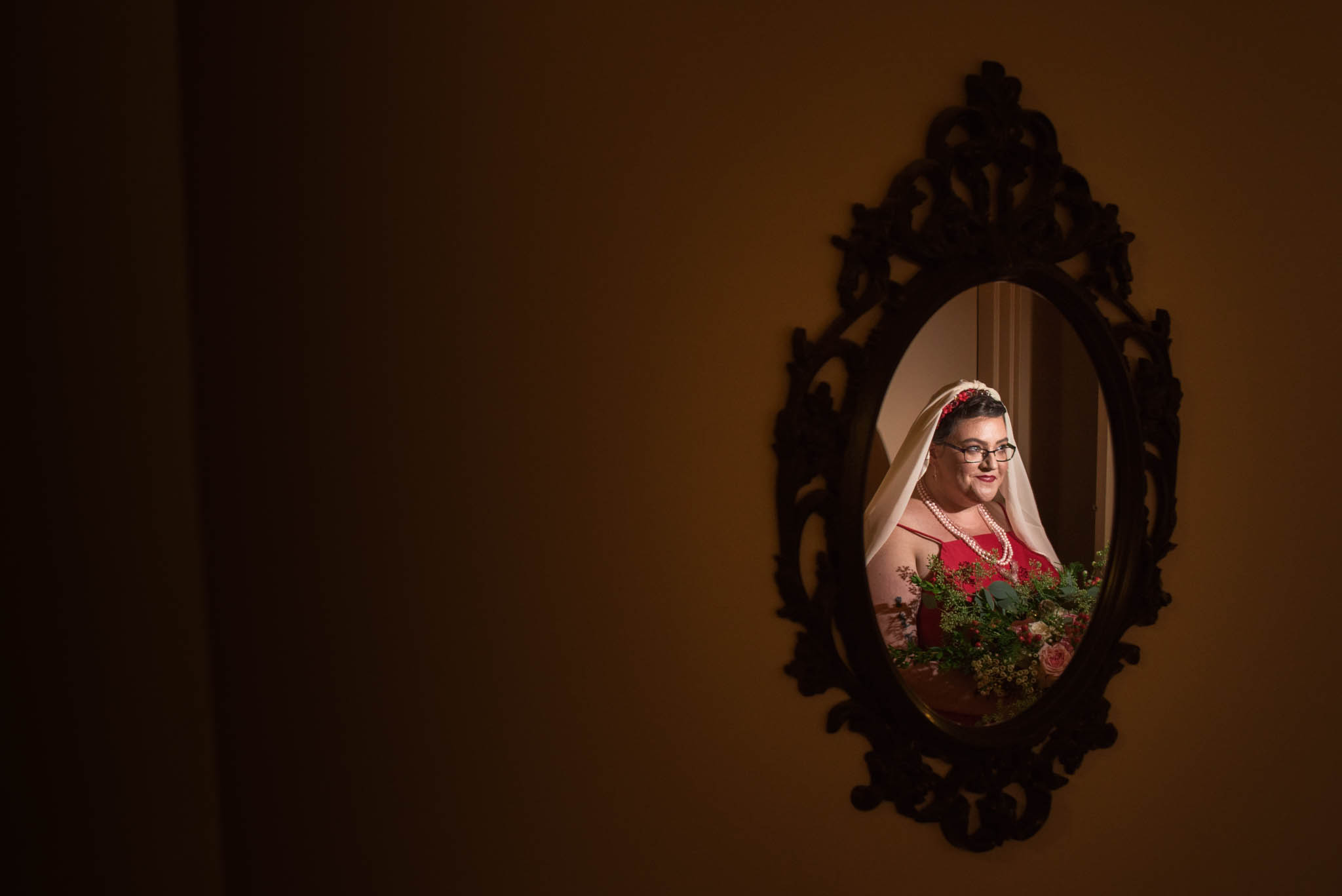 Portrait of a bride wearing red in a mirror
