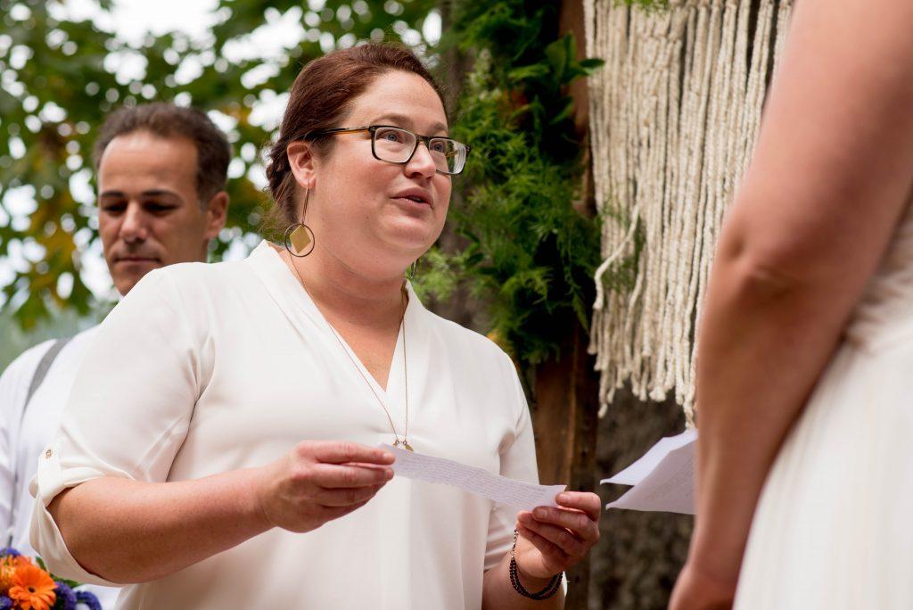 Bride reading her wedding vows in Oregon