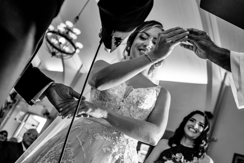 bride taking her wedding ring during wedding ceremony