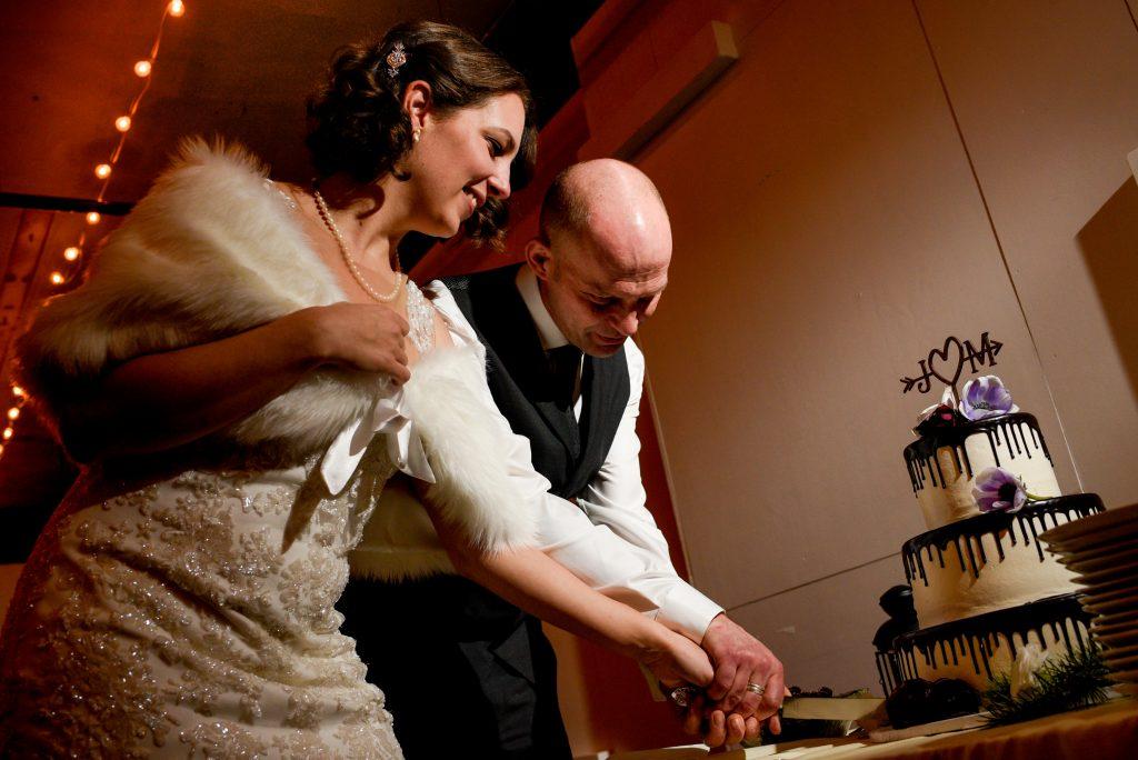 Bride and groom cutting their wedding cake.