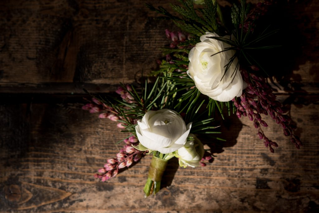 Wedding flowers on the wooden floor inside of Union Pine