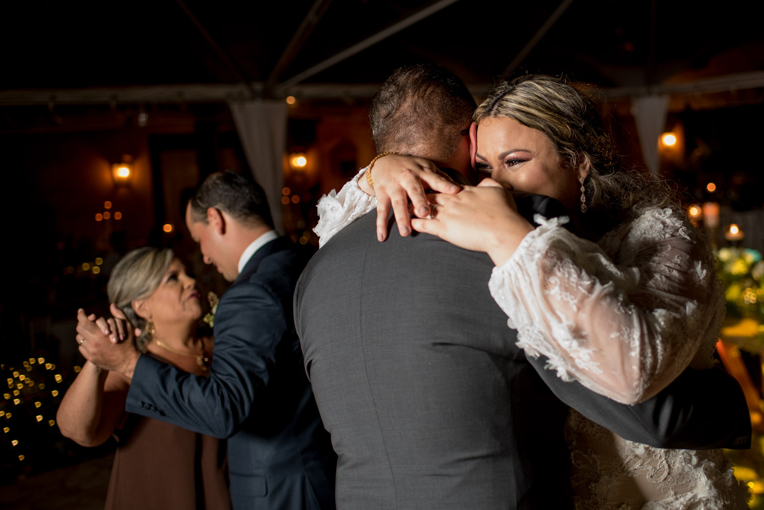 Father daughter and mother son dances during wedding reception